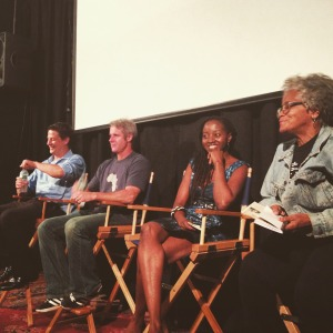 Photo of panelists in chairs on a stage at the NY African Film Festival